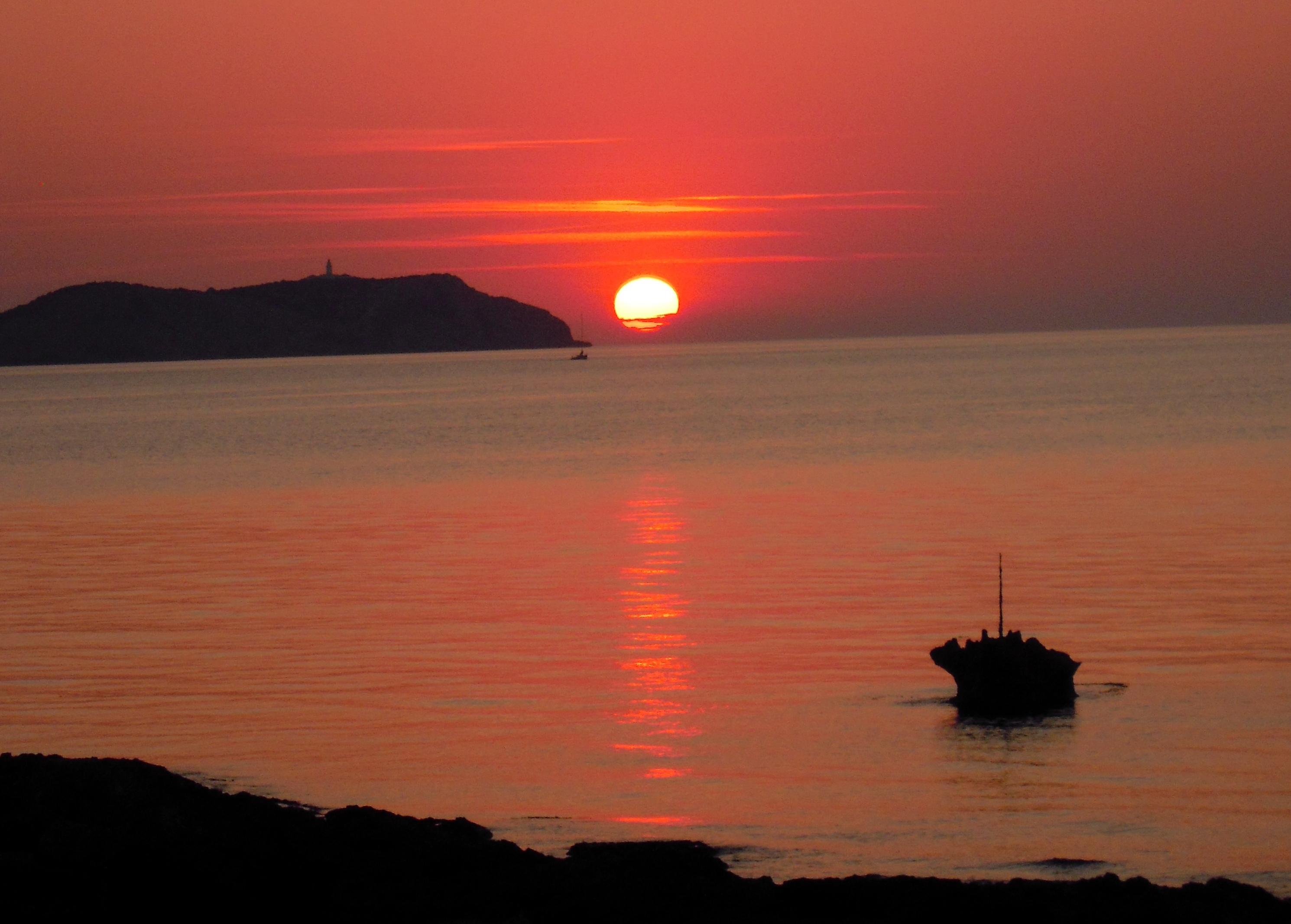 Sunset_across_Port_des_Torrent_San_Antonio_Bay_29_May_2012